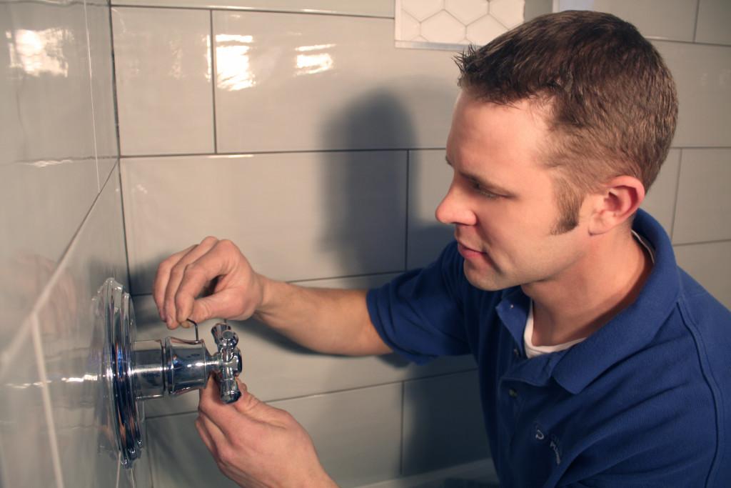 A plumber assembling a shower valve.